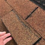 Wind Damage - Curled Shingles - A Jenkins Inc